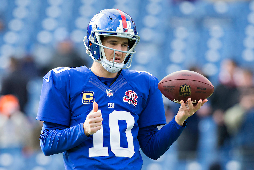 NASHVILLE, TN - DECEMBER 7:  Eli Manning #10 of the New York Giants warming up before a game against the Tennessee Titans at LP Field on December 7, 2014 in Nashville, Tennessee.  The Giants defeated the Titans 36-7.  (Photo by Wesley Hitt/Getty Images) *** Local Caption *** Eli Manning
