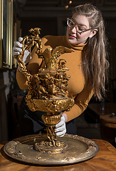 The Bonham's Home & Interiors Sale takes place on 21-22 February and features  a wide array of silver and porcelain.<br /> <br /> Pictured: Jaine Heggie with a French ewer and basin adorned with a frieze depicting the Dance of the Willis from the ballet Giselle (est. £5000 -£8000)