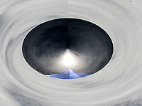 black hole with mist in white vortex background with two shapes like peaks inside and white shades,one peak blue and one peak of light