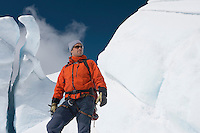 Mountain climber in front of ice formation
