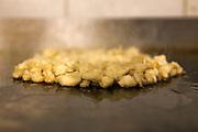 Garlic cloves grilling on a Griddle