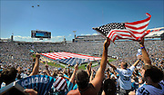Jacksonville Jaguars fans wave flags and cheer as two military jets perform a fly over during pre-game ceremonies before an NFL football game against the Tennessee Titans in Jacksonville, Fla., Sunday, Sept. 11, 2011.(AP Photo/Stephen Morton)