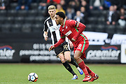 Swansea City midfielder Leroy Fer (8) with Notts County forward Jonathan Stead (30) closing in during the The FA Cup 4th round match between Notts County and Swansea City at Meadow Lane, Nottingham, England on 27 January 2018. Photo by Jon Hobley.