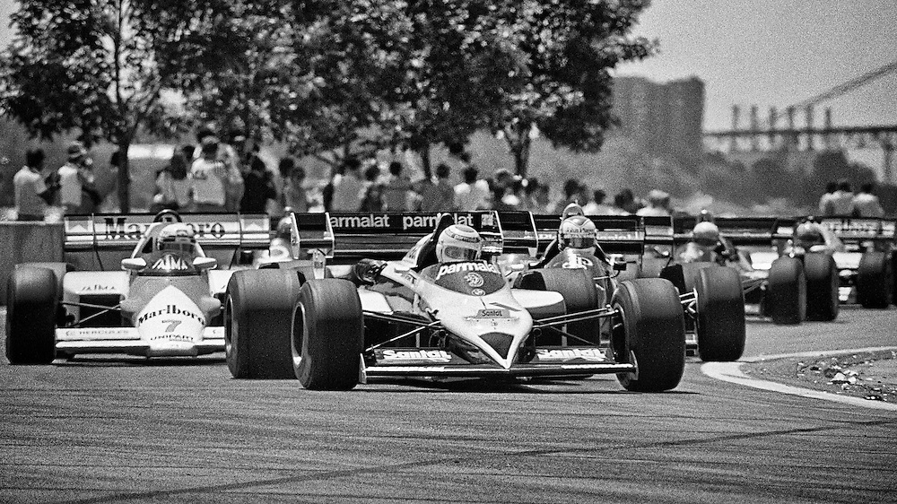 Two-time Brazilian World Champion Formula One driver Nelson Piquet puts his Parmalat Brabham BMW in the lead of the 1984 Detroit Grand Prix. Piquet had won the Canadian Grand Prix the prior weekend and would win from the pole while fellow drivers Alain Prost and Nigel Mansell would retire. <br />