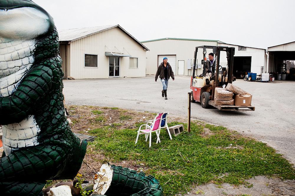 Stephen Bonnecarrere (R) waits for a worker at Daneco Alligator Farm in Houma, Louisiana on Friday, February 19, 2010.