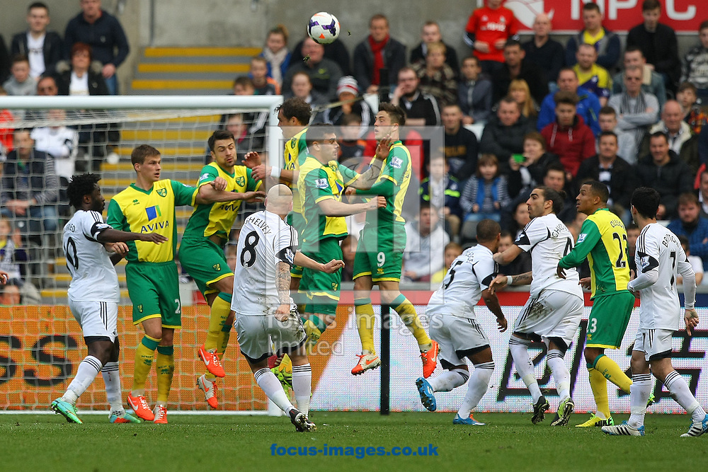 Jonjo Shelvey of Swansea has a shot on goal from a free kick during the Barclays Premier League match at the Liberty Stadium, Swansea<br /> Picture by Paul Chesterton/Focus Images Ltd +44 7904 640267<br /> 29/03/2014