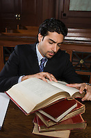 Man reading in court
