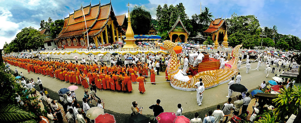 A funeral procession for the death of an abbott beginning outside Senn Temple in Luang Prabang, Laos.