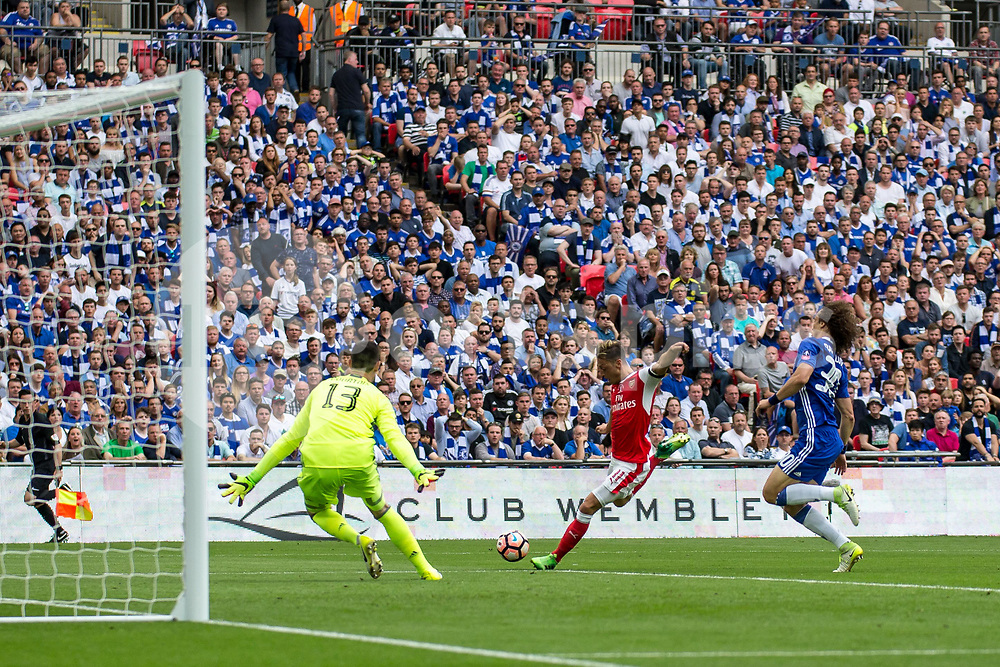 Mesut Ozil of Arsenal shoots only to see his shot cleared off the line by Gary Cahill of Chelsea during the Emirates FA Cup Final between Arsenal and Chelsea at Wembley Stadium, London, England on the 27th May 2017. Photo by Liam McAvoy.