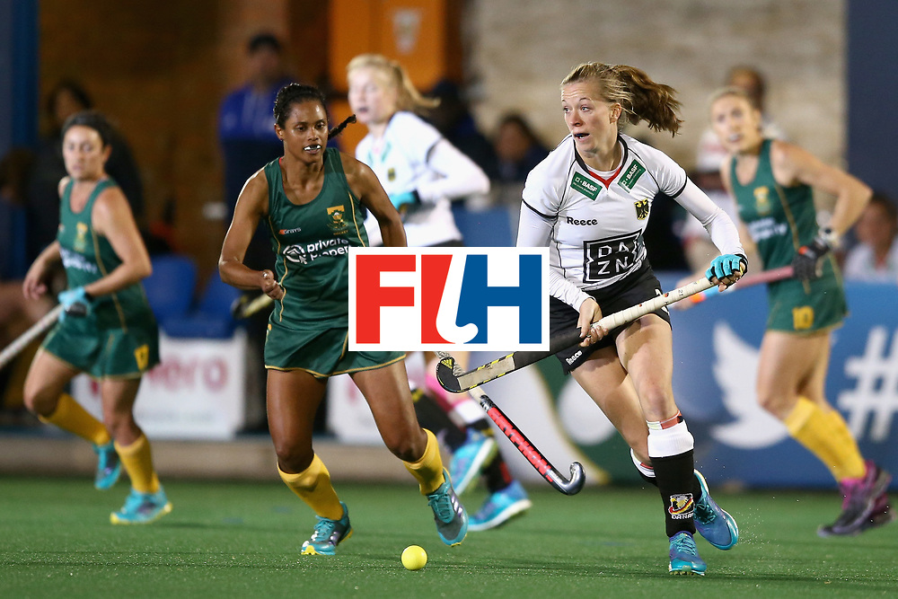 JOHANNESBURG, SOUTH AFRICA - JULY 18: Franzisca Hauke of Germany attempts to get away from Illse Davids of South Africa during the Quarter Final match between Germany and South Africa during the FIH Hockey World League - Women's Semi Finals on July 18, 2017 in Johannesburg, South Africa.  (Photo by Jan Kruger/Getty Images for FIH)