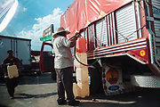 Huixcolotla, Mexico – March 27, 2017: A man fulls the tank of a truck; the ilegal gasoline price is $7 pesos per liter (0.37 dollars), while in the gas station is sold by $17 pesos per liter (0.91 dollars). Rodrigo Cruz for The New York Times