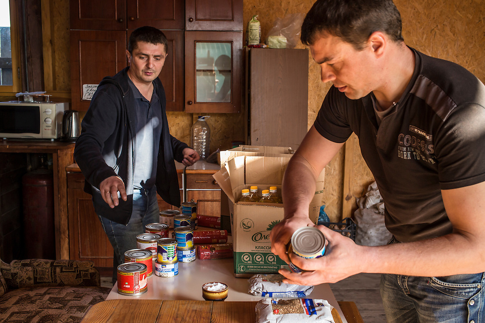 Internally displaced people who fled the besieged city of Donetsk sort food donated by the Red Cross in the communal kitchen in the small seaside resort that has become their home on Tuesday, October 14, 2014 in Berdyansk, Ukraine. Photo by Brendan Hoffman, Freelance
