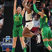 March 31, 2019; Portland, OR, USA;  Oregon Ducks forward Erin Boley (21) defends Mississippi State Bulldogs forward Anriel Howard (5) in the Elite Eight of the NCAA Women's Tournament at Moda Center.<br /> Photo by Jaime Valdez