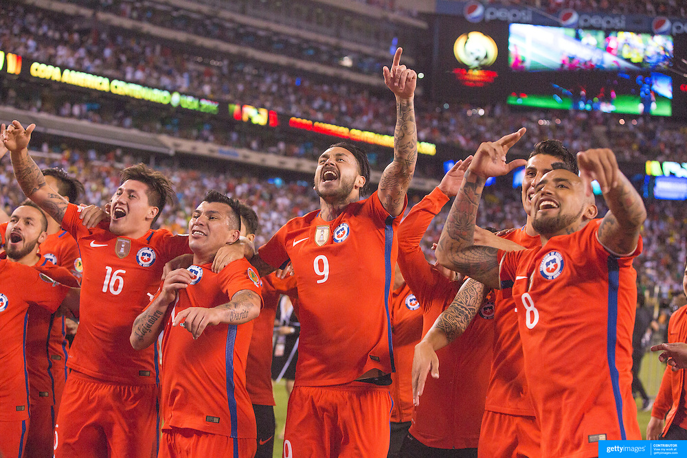 EAST RUTHERFORD, NEW JERSEY - JUNE 26: Nicolas Castillo #16 of Chile, Gary Medel #17 of Chile, Mauricio Pinilla #9 of Chile, Arturo Vidal #8 of Chile and other team members celebrate victory during the Argentina Vs Chile Final match of the Copa America Centenario USA 2016 Tournament at MetLife Stadium on June 26, 2016 in East Rutherford, New Jersey. (Photo by Tim Clayton/Corbis via Getty Images)
