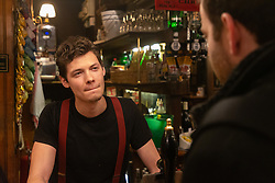 Croatian acting student and bar man at The Ship And Shovell pub in Charing Cross talks with Bild journalist Philip Fabian about Brexit in London. London, January 16 2019.