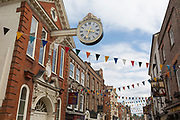 The 18th century historic Sir Cloudesley Shovell Corn Exchange clock (1771) in Rochester High Street, on 22nd July, in Rochester, England. The historic timepiece, a gift from Sir Cloudesley who was MP for Rochester from 1695 to 1701, has recently been restored at a cost of £40,000 after centuries of wear and tear took its toll and much of the clock had to be dismantled for safety reasons.