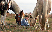 Paul Limmer, 10, of Osteen, Fla. lets his horse graze at their campsite after riding the first of three days of the 2006 Great Florida Cattle Drive in Osceola County.