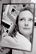 Woman looking in mirror, London, UK, 1987.