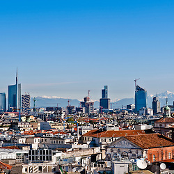 New panoramic skyline in Milan 2012. The picture was taken from the Duomo cathedral rooftop facing north and shows the new buildings from the Isola and Garibaldi districts. The new skyscrapers have been built in 2011. The Alps, less than 50 miles away, are on the background.