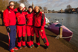 Marlow, Bucks, January 24th 2015. Olympic and Paralympic rowing medallists including Naomi Riches, Heather Stanning and Katherine Grainger join members of a Coxless Crew at Marlow at their boat naming ceremony. The Coxless Crew is a team of four women who have given up their jobs to undertake an epic six-month 8,446 mile adventure rowing their boat Doris across the Pacific ocean from Sanfrancisco to Cairns in Australia, to raise funds for charities Walking With The Wounded and Breast Cancer Care. PICTURED: Paralympian Naomi Riches poses with Laura Penhaul, Emma Mitchell and Natalia Cohen at Doris's mooring on the Thames.
