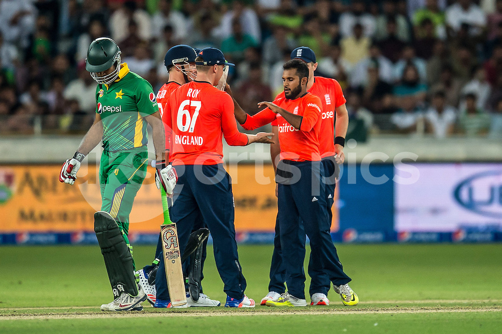 Adil Rashid of England  is congratulated on the wicket of Sohaib Maqsood of Pakistan during the 2nd International T20 Series match between Pakistan and England at Dubai International Cricket Stadium, Dubai, UAE on 27 November 2015. Photo by Grant Winter.