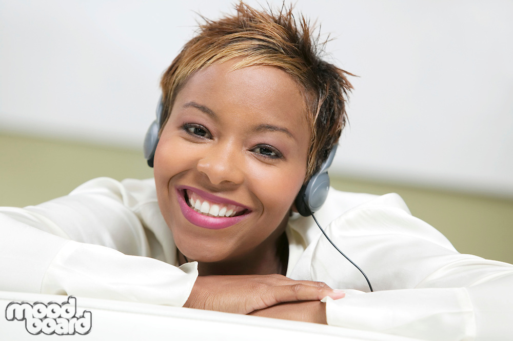 Attractive Young Woman Listening to Headphones