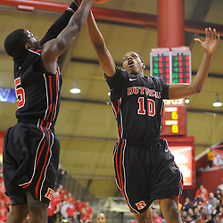Rutgers Scarlet Knights guard Eli Carter (5) and guard/forward Mike Poole (10) jump for a rebound during first half Big East NCAA Basketball between the Rutgers Scarlet Knights and Seton Hall Pirates at the Louis Brown Athletic Center. Rutgers leads Seton Hall 28-26 at halftime.