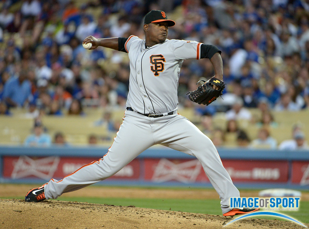 Apr 6, 2014; Los Angeles, CA, USA; San Francisco Giants reliever Juan Gutierrez (57) delivers a pitch against the Los Angeles Dodgers at Dodger Stadium. The Dodgers defeated the Giants 6-2.