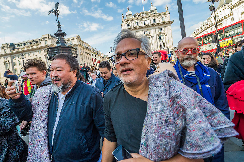 Both in Piccadilly Circus in front of Eros - Anish Kapoor and Ai Weiwei go for a walk in London - The two artists have joined hands to walk out of London on Thursday. Each will carry a single blanket as a symbol of the need that faces 60 million refugees in the world today. The Artists have said that they welcome Londoners to join them along their route and ask that Londoners too bring a blanket in gesture of support. The artists will repeat this action in cities across the world over the next few months. The walk started at 10am on Thursday 17th September, at the Royal Academy of Arts passed: Piccadilly Circus; Trafalgar Square; Whitehall;  St Paul's Cathedral; Bank and ended up at Stratford.