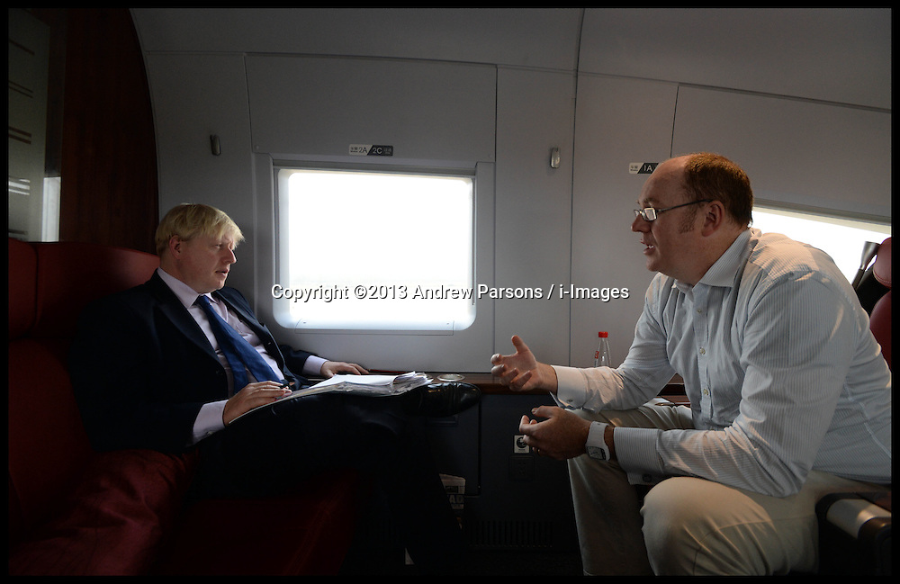 The London Mayor Boris Johnson with his economic adviser Gerard Lyons working on the train from Beijing to Shanghai on Day 4 of his Trade Mission to China, Wednesday, 16th October 2013. Picture by Andrew Parsons / i-Images
