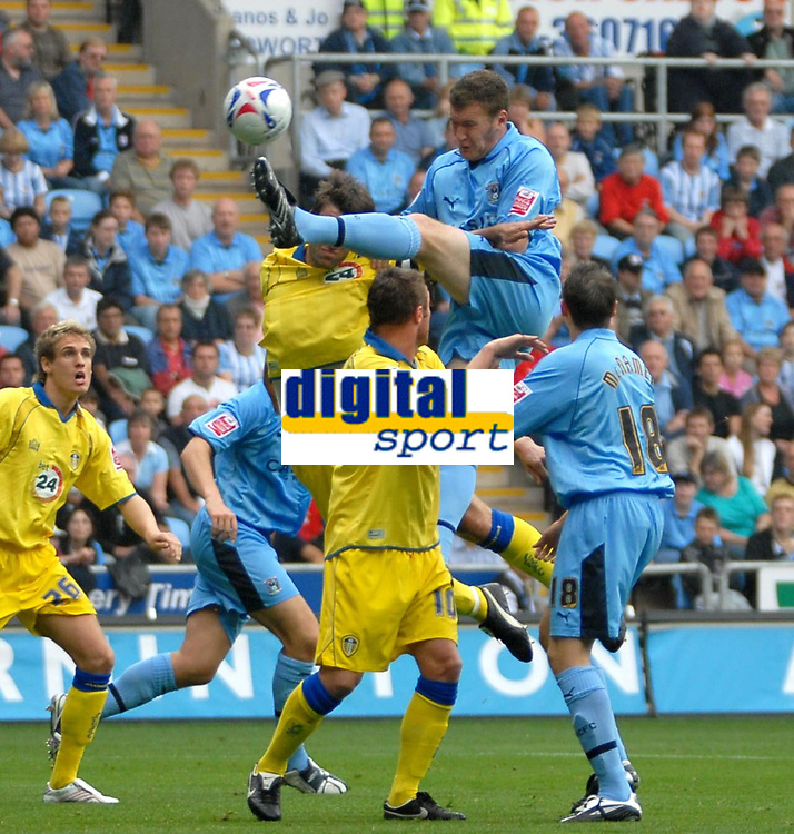 Photo: Ed Godden.<br />Coventry City v Leeds United. Coca Cola Championship. 16/09/2006. Coventry's Kevin Kyle leaps high above the Leeds defence.