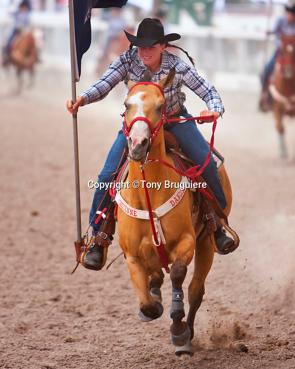 One of the Dandies,Cheyenne Frontier Days  precision riding team, races around the arena during the 2009 event held in Cheyenne, Wyoming.