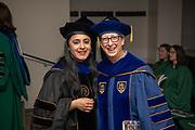 Devika Chawla (Left) with Susan Burgess at gradute commencement. Photo by Ben Siegel