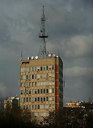 PRISTINA, KOSOVO - DECEMBER 14 - glavna stavba operaterja IPKO, obenem stavba radia, antena na strehi.