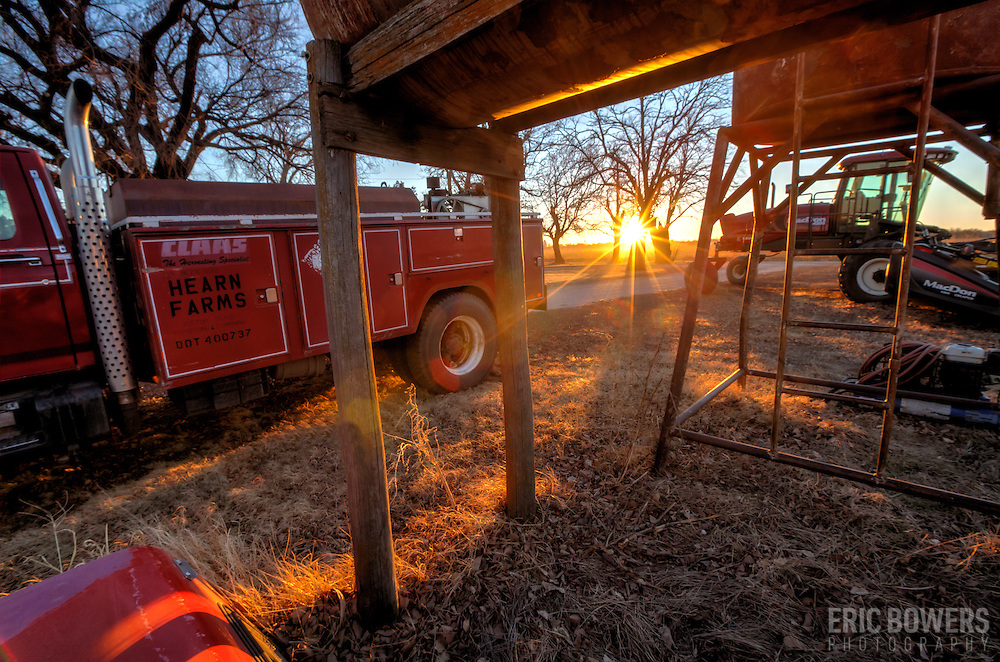 Lens flare at sunset on a rural Kansas farm.