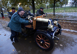 Dawn in Hyde Park, London as a competitor gets a push off  at the start of the London to Brighton Veteran Car Run Sunday  4th November 2012.   Photo by: Stephen Lock / i-Images