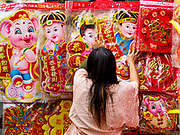11 JANUARY 2019 - BANGKOK, THAILAND: A vendor sets up her display of Chinese New Year decorations in Bangkok's Chinatown. About 14% of Thais are of Chinese ancestory and Lunar New Year is widely celebrated in Thailand. Chinese New Year celebrations in Bangkok start on February 4, 2019. The coming year will be the Year of the Pig in the Chinese zodiac.       PHOTO BY JACK KURTZ