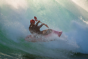 Barny Young catches air in the surf at Cobden, Greymouth.