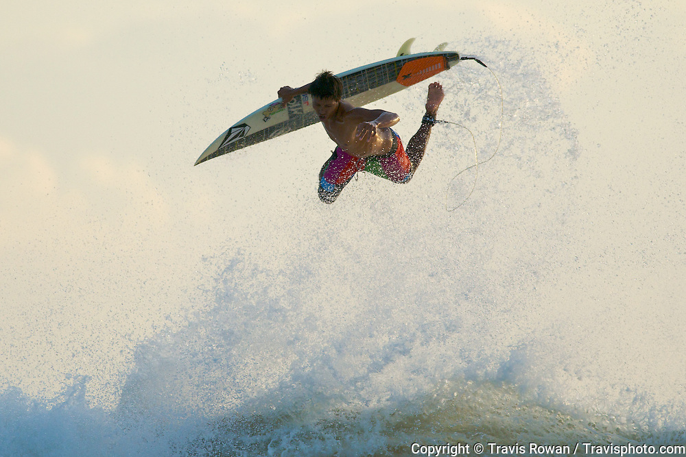 "Professional Balinese surfer, ""Bol"" stylishly ejects from a close out wave."