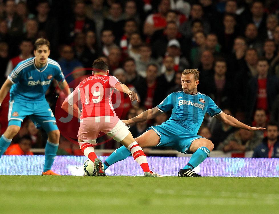 Arsenal's Santi Cazorla is tackled by Sunderland's Lee Cattermole - Photo mandatory by-line: Robbie Stephenson/JMP - Mobile: 07966 386802 - 20/05/2015 - SPORT - Football - London - Emirates Stadium - Arsenal v Sunderland - Barclays Premier League