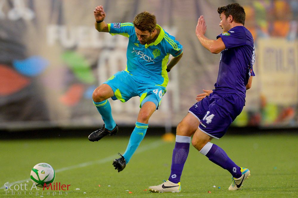Seattle Sounders midfielder Blair Gavin (46) and Orlando City Lions midfielder Luke Boden (14) during a USL Pro soccer game at the Citrus Bowl on Aug. 11, 2013 in Orlando, Florida. <br /> <br /> &copy;2013 Scott A. Miller