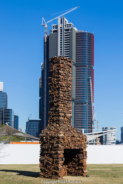 Sculpture at Barangaroo showing artwork titled Empirical View, 2016, a seven metre high firewood chimney, by artist Marcus Tatton. This monument represents Tatton's acknowledgement of the sites history. The art show falls at the same time  as Barangaroo Reserve celebrates its first birthday.