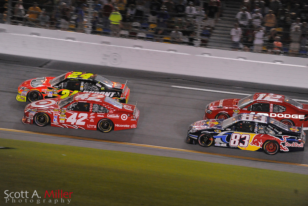 July 3, 2010; Daytona Beach, FL, USA; Juan Montoya (42), Jeff Gordon (24), Brad Keselowski (12) and Reed Sorenson (83) during the Coke Zero 400 at Daytona International Speedway. ..Scott A. Miller