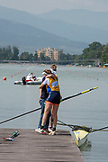 Plovdiv, Bulgaria, {DATE, }FISA, Rowing World Cup 1,  W2-, NED, Coach congratulates Jose VAN VEEN and Aletta JORRITSMA, after they had won Gold in W2- Final, ,[© Karon PHILLIPS/ Intersport Images]