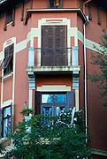 Elegant balcony and shuttered windows. Opatija, Croatia