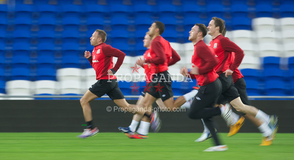 CARDIFF, WALES - Monday, March 18, 2013: Wales' Craig Bellamy during a training session at the Cardiff City Stadium ahead of the 2014 FIFA World Cup Brazil Qualifying Group A match against Scotland. (Pic by David Rawcliffe/Propaganda)
