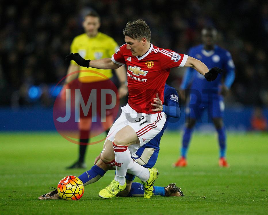 Jamie Vardy of Leicester City tackles Bastian Schweinsteiger of Manchester United (L)  - Mandatory byline: Jack Phillips/JMP - 07966386802 - 28/11/2015 - SPORT - FOOTBALL - Leicester - King Power Stadium - Leicester City v Manchester United - Barclays Premier League