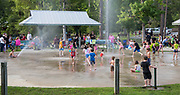 Children enjoy the splash pad while folks gather in Abita Springs Park before fireworks on July 2, 2017