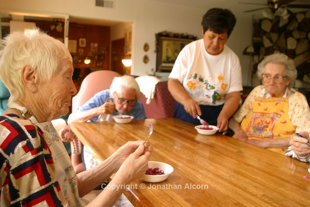 Meal time at a home converted into a live-in residence for Alzheimers and dementia related  patients.