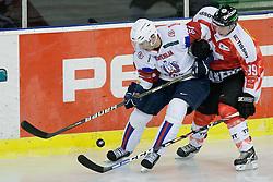 Sabahudin Kovacevic of Slovenia and Pascal Berger during friendly ice-hockey match between Slovenia and Switzerland, on December 14, 2011 at Hala Tivoli, Ljubljana, Slovenia. (Photo By Matic Klansek Velej / Sportida)